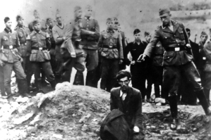 The Final Solution to the Jewish Question: An Einsatzgruppe D soldier about to shoot a Jew kneeling at a partially filled mass grave in Vinnitsa, Ukrainian SSR, Soviet Union, in 1942. The Einsatzgruppen were SS paramilitary task forces whose main purpose
